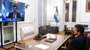 En pantalla Claudio Moroni. A la derecha, Sergio Masa, presidente de la Cámara de Diputados de la Nación.